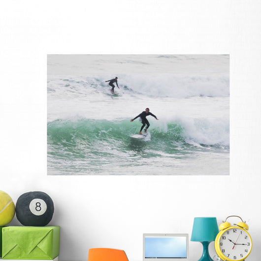 Surfers riding waves Wall Mural