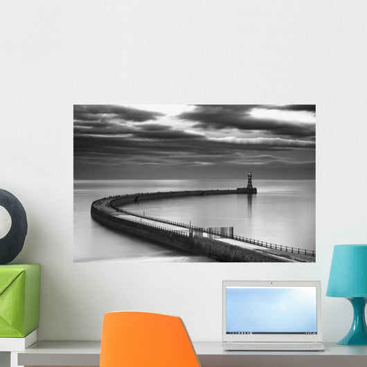 A curving pier with a lighthouse Wall Mural