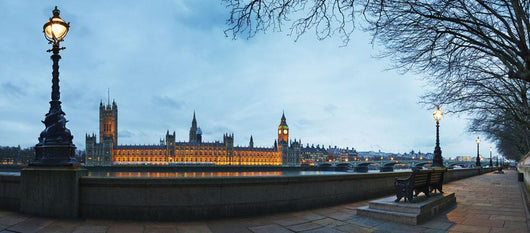 UK, Panoramic view of Houses of Parliament at dusk from River Thames Wall Mural