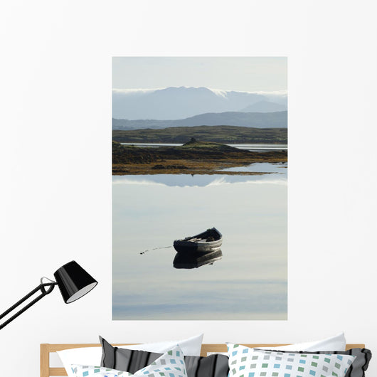 A rowboat sits Wall Mural