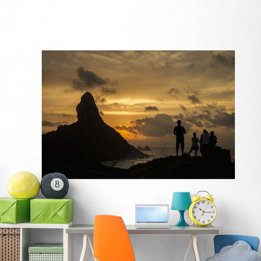People admiring sunset over Morro do Pico from Forte dos Remedios Wall Mural