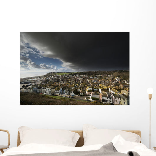 England, East Sussex, Thunderstorm over coastal resort town Wall Mural