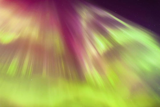 A Green And Purple Northern Lights Corona Wall Mural