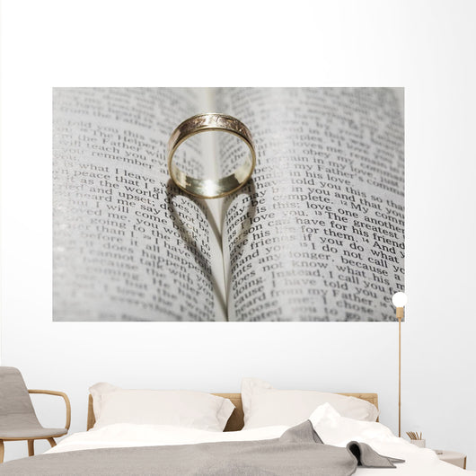Close up of a gold ring with the shadow of an heart Wall Mural