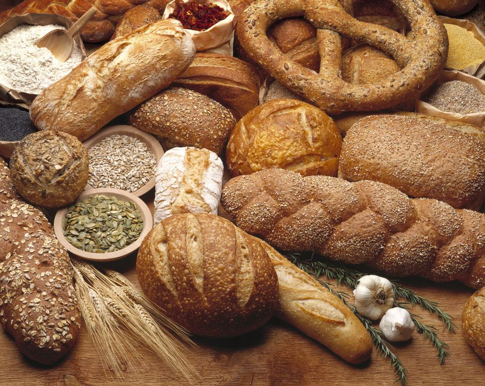 Food - Various types of breads and some of their ingredients Wall Mural