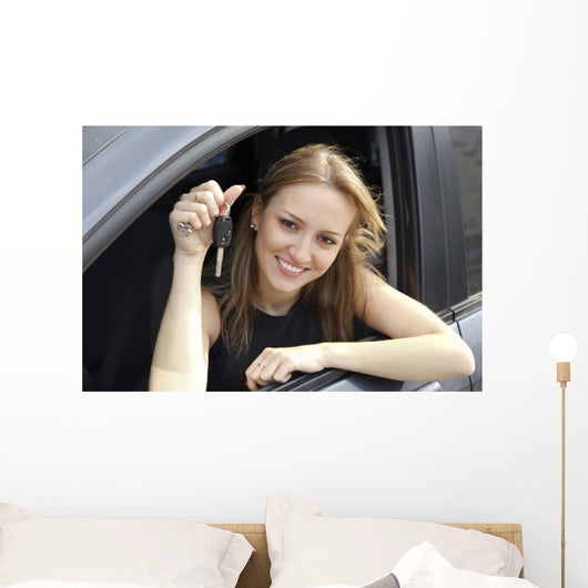 Happy Woman Showing Key Wall Decal