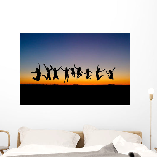Silhouette Friends Jumping Sunset