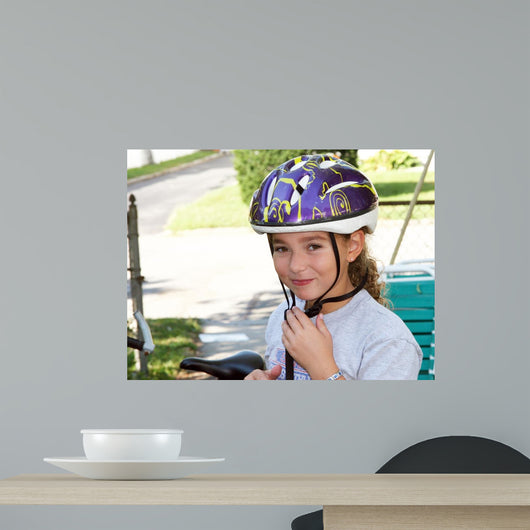 Cute Girl in a Helmet Is Going for a Ride Wall Mural