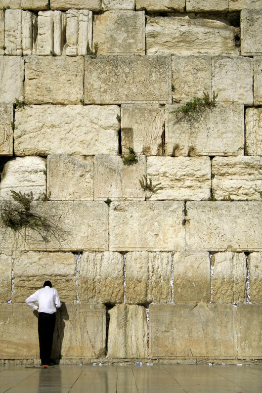 man praying next to the wailing wall, jerusalem,israel Wall Mural