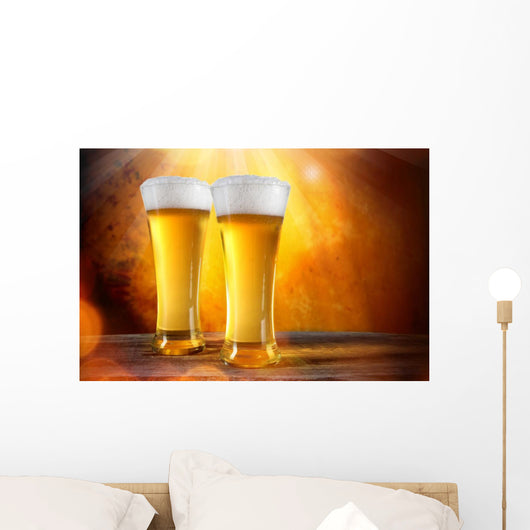 Beer in a glasses with gold background Wall Mural