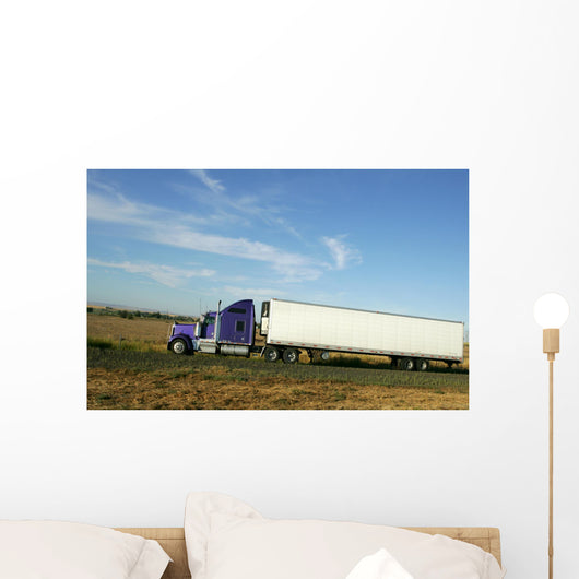 Semi truck going fast on interstate highway Wall Mural