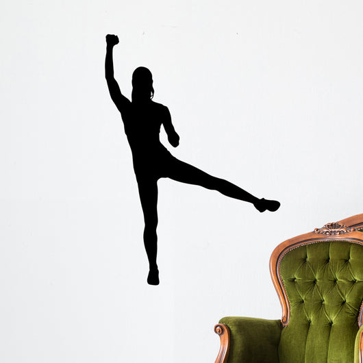A silhouette of an attractive woman lifting weights Wall Decal