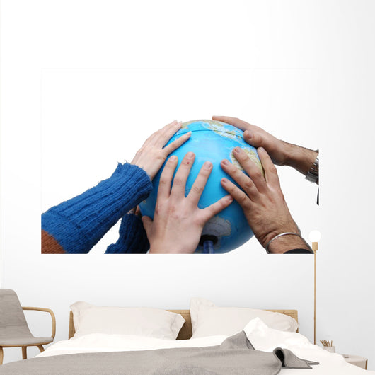 Teamwok concept with hands on globe Wall Decal