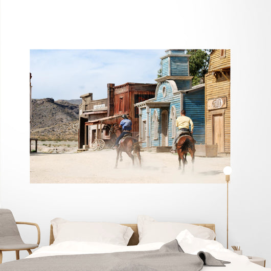 Two cowboys in a traditional American western town Wall Mural
