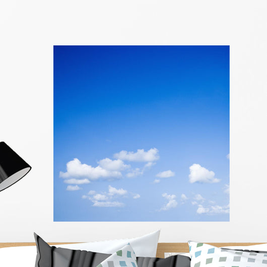 Blue sky with some white puffy clouds. Wall Decal