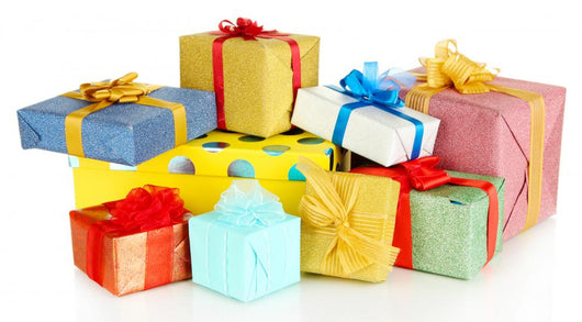 Pile of colorful gifts boxes isolated on white