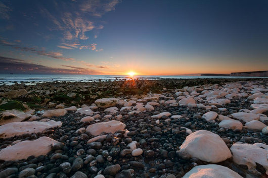Sunset over white rocks at Birling Gap, Sussex, England