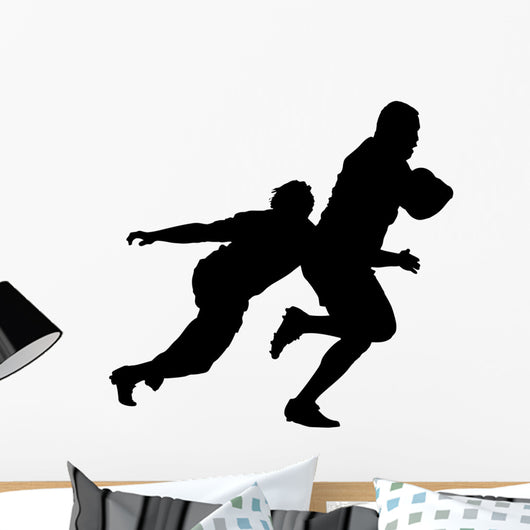 Side Profile of Rugby Player Tackling Runner With Ball Wall Decal