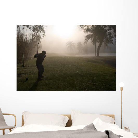 Early Morning Golfers in a Dense Fog