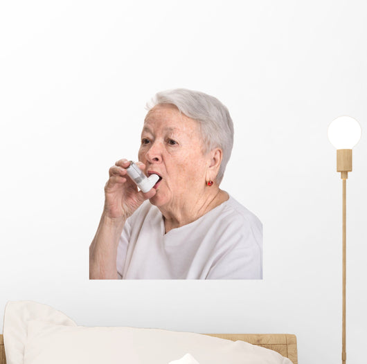 Senior woman with asthma inhaler Wall Decal
