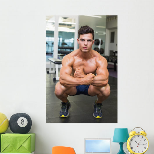 Shirtless Muscular Man Flexing Muscles in Gym Wall Mural