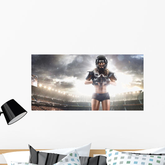 American football female player is posing Wall Mural