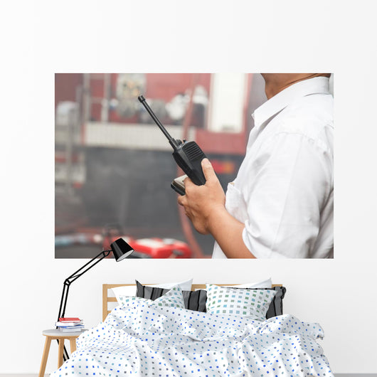 Man using walkie talkie Wall Mural