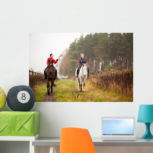Young woman riding a horse Wall Mural