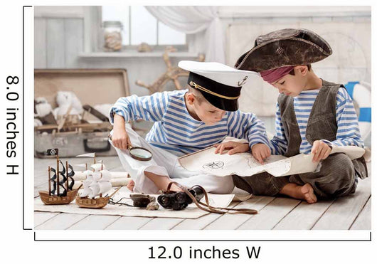 Boys dressed as a pirate captain and read travel map Wall Mural