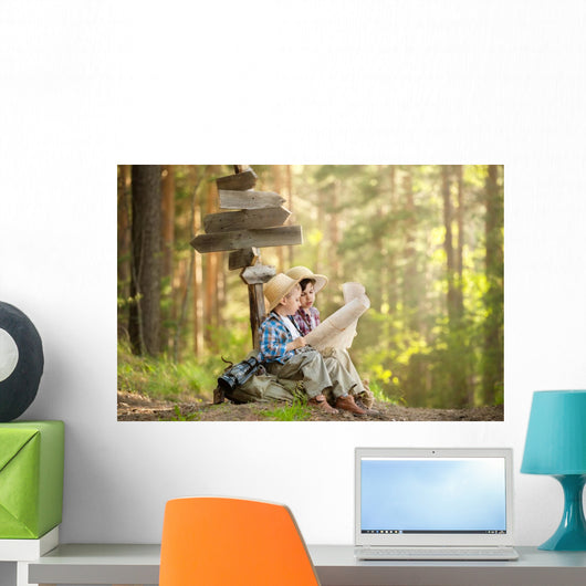 Boys on a forest road with backpacks Wall Mural
