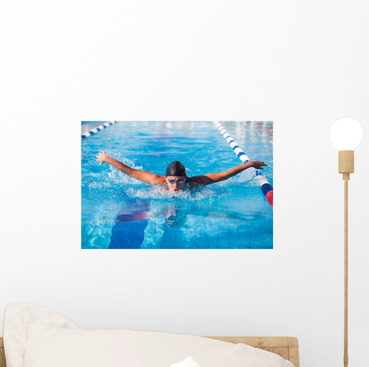 Butterfly swimmer Wall Mural