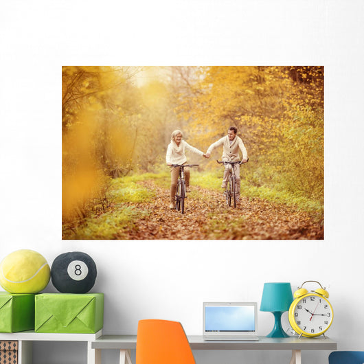 Active seniors riding bike Wall Mural