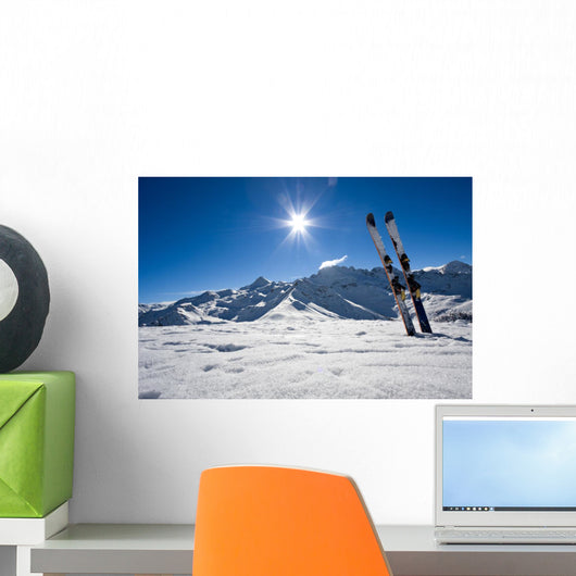 Skis in snow at Mountains Wall Mural
