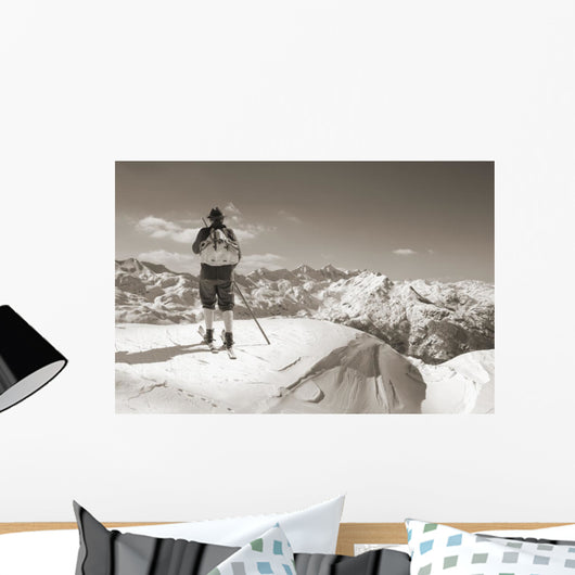 Sepia Vintage skier with wooden skis Wall Mural