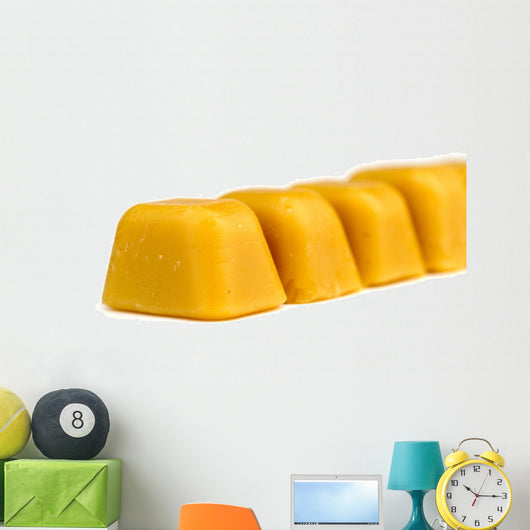 Blocks of natural Australian beeswax isolated on white Wall Mural