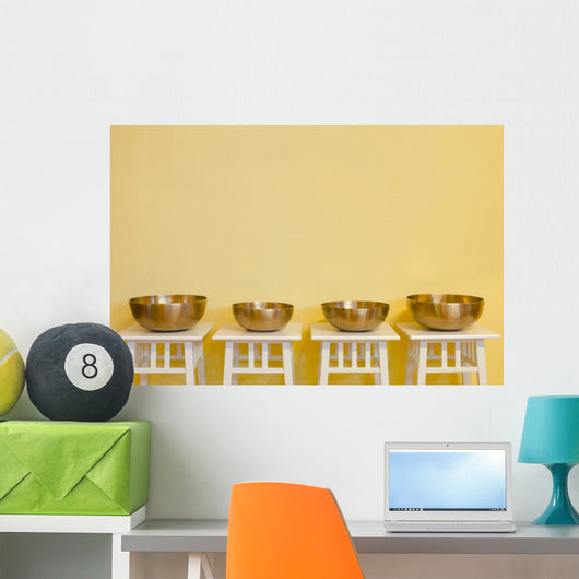 row of therapeutic Tibetan singing bowls Wall Mural