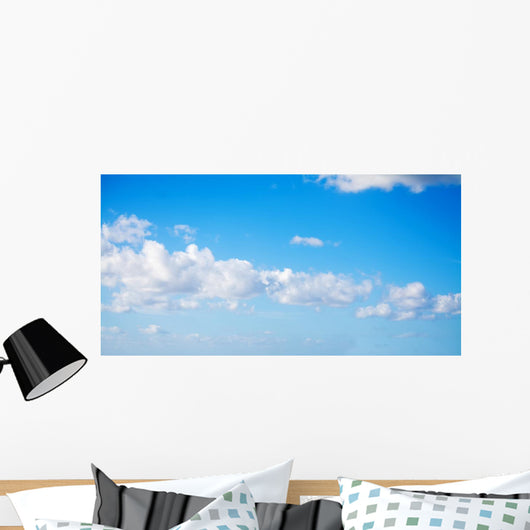 white clouds in the blue sky Wall Mural