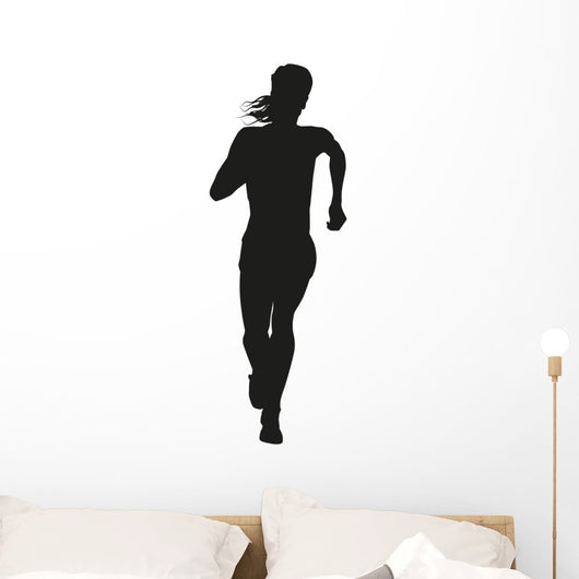 Silhouette of a woman running long distance Wall Decal