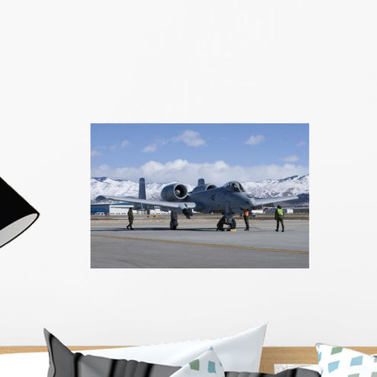 Maintenance Crews Perform End Wall Decal