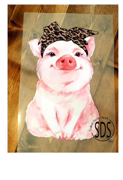 Pig with leopard bandana