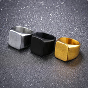 Gold, Silver, and Black Block Rings
