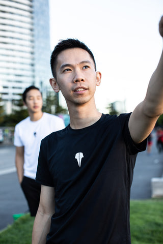 Henry Wong pointing in the distance Jeff Tho in the background