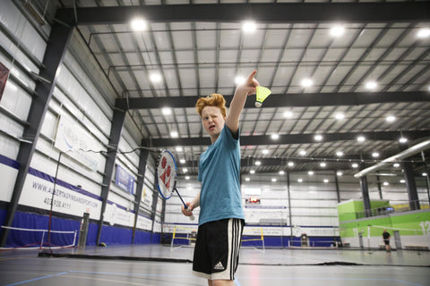 Red Head Young Boy Playing Badminton Pointing Racket Finger