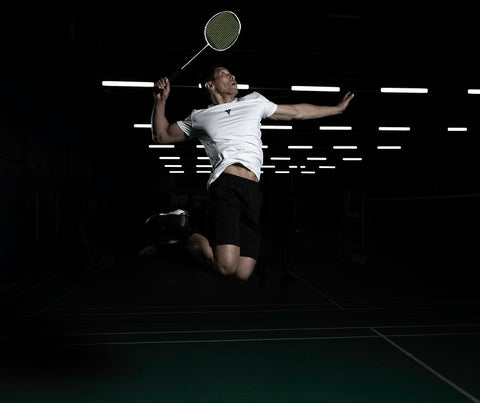 Man jump smash badminton shuttle racket