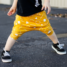 Load image into Gallery viewer, toddler boy toddler girl mustard yellow and white shapes drop crotch harem shorts