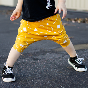 toddler boy toddler girl mustard yellow and white shapes drop crotch harem shorts