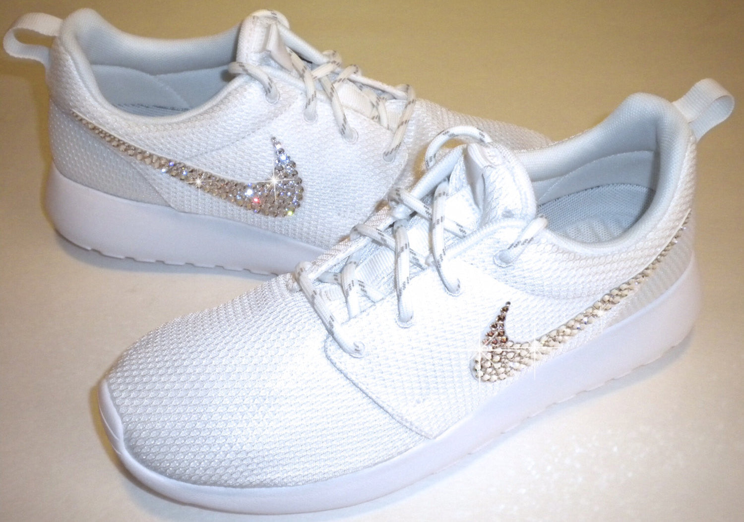 ... closeout all white bling nike roshe one shoes bedazzled with authentic  swarovski crystals for maximum sparkle 72423e336