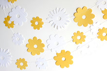 Yellow and white paper flowers garland