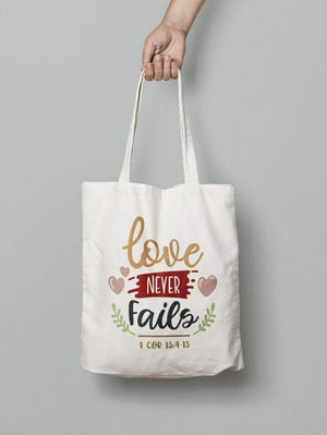 Living Words Love Never Fails - Tote Bag