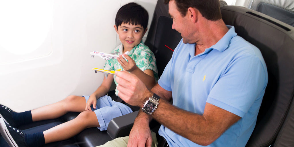 Plane Pal with Kid and Dad on Airplane Seat